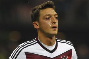 hi-res-450217809-mesut-oezil-of-germany-looks-on-during-the_crop_north